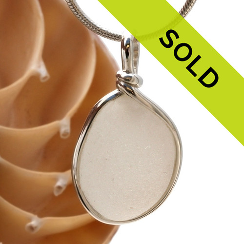 SOLD - This sea glass jewelry item has been sold. A nice pure white natural sea glass piece set in our Original Wire Bezel setting in Solid Sterling Silver setting.