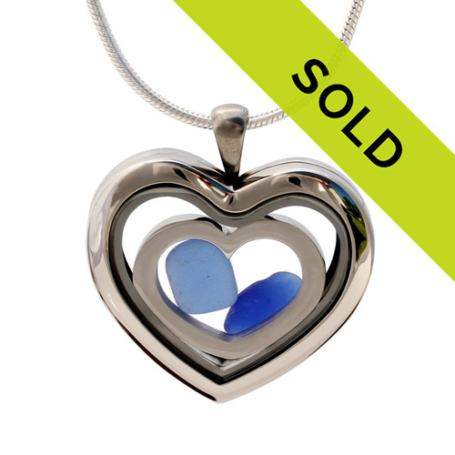 A natural blue sea glass heart combined a large silver heart in this sea glass locket necklace. Sorry this locket has been sold!