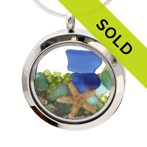Cobalt Blue and aqua beach found sea glass  are combined with a small starfish and vivid lime green beads in this one of a kind sea glass locket necklace.