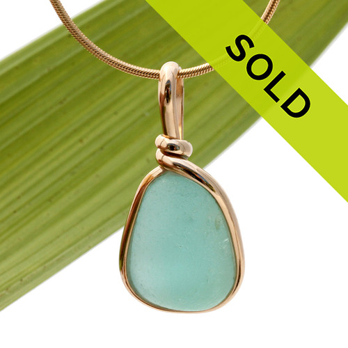 A perfect piece of aqua blue with in our signature Original Wire Bezel© pendant setting that leaves both front and back open and the glass unaltered from the way it was found on the beach. Sorry this sea glass jewelry pendant has been sold!