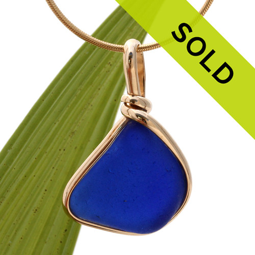 A perfect triangle shaped piece of natural blue sea glass set in our 14K goldfilled bezel setting. Sorry this piece has been sold!