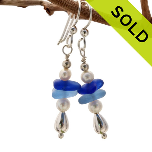 Light and dark blue sea glass are combined with fresh water pearls in this dangly pair of sea glass earrings. Sorry this Sea Glass Jewelry selection has been SOLD!
