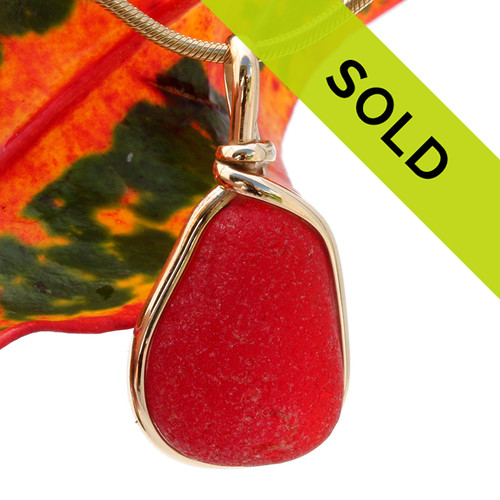 Ultra rare vivid large red sea glass from Seaham England in our Original Wire Bezel© setting in 14K Rolled Gold. Sorry this rare red sea glass pendant has been sold!