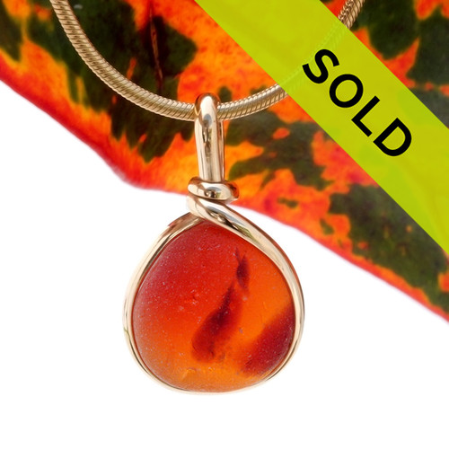 A very unusual piece that seems to be a piece of mixed Amberina glass set in our signature Original Wire Bezel© rolled gold setting. Sorry this amazing Ultra Rare Sea Glass Jewelry piece has been SOLD!