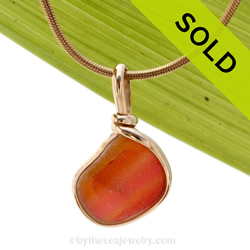 An ULTRA RARE mixed Pink and Orange sea glass piece set in our signature Original Wire Bezel© rolled gold setting. Sorry this ultra rare sea glass pendant has been sold!