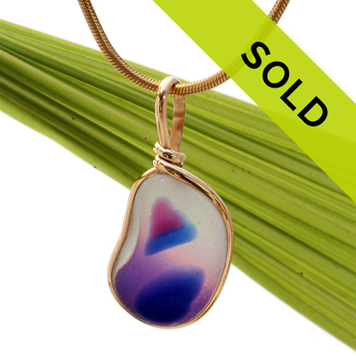 A stunning mixed hot pink, vivid blue and pure white English sea glass from Seaham England set in our Original Wire Bezel© necklace pendant setting in gold.