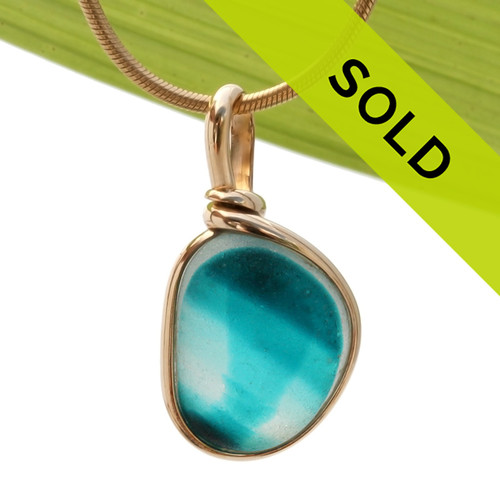 This is a stunning piece of End Of Day Sea glass in electric teal set in our Original Wire Bezel© setting in gold.