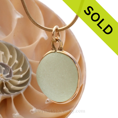 A larger thick and round seafoam pale green sea glass with in our Horseshoe Wire Bezel© pendant setting that leaves both front and back open and the glass unaltered from the way it was found on the beach. Sorry this Sea Glass Jewelry Selection is NO LONGER AVAILABLE!