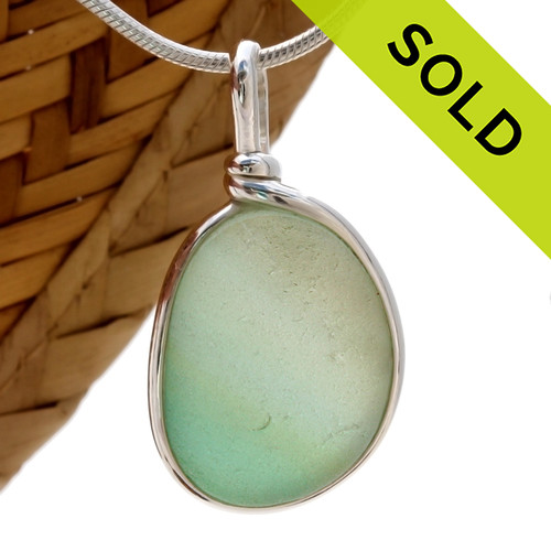 A perfect size piece of Certified Genuine Sea Glass. This is done in our Original Wire Bezel© setting that leaves both front and back open for maximum color. Sorry this Sea Glass Jewelry selection has been sold!