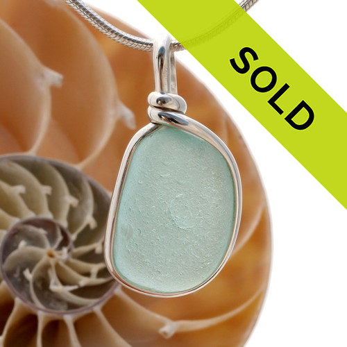 A perfect piece of pale aqua blue sea glass in our Original Wire bezel© necklace pendant setting.