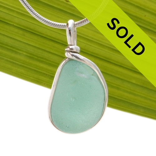 A chunky piece of aqua blue sea glass in our Original Wire bezel© necklace pendant setting. Sorry this sea glass jewelry piece has  been sold!