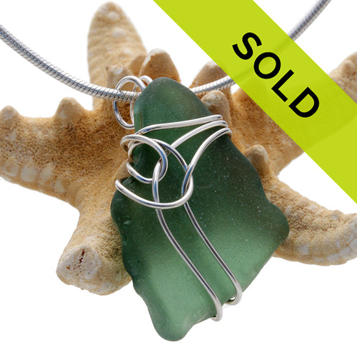 A larger chunky piece of deep aqua green sea glass set in our triple deco sterling silver pendant setting. Sorry this pendant has been sold!