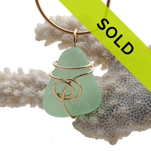 A simply set piece of vivid seafoam green sea glass from Puerto Rico. Sorry this sea glass necklace pendant has been sold!