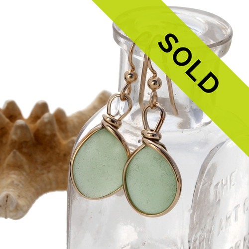 Genuine beach found seafoam green sea glass earrings in a 14K Rolled Gold Original Wire Bezel setting. Sorry this pair of sea glass earrings has sold!