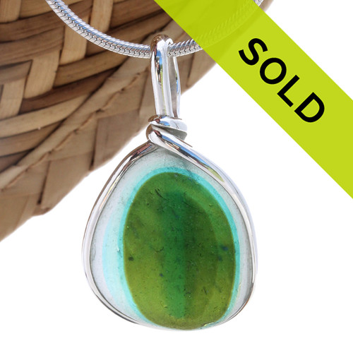 A beautiful larger piece of mixed sea glass with a vivid green and aqua center set for a necklace in our Original Sea Glass Bezel© in solid sterling silver setting. Sorry this one of a kind sea glass jewelry piece has been sold!