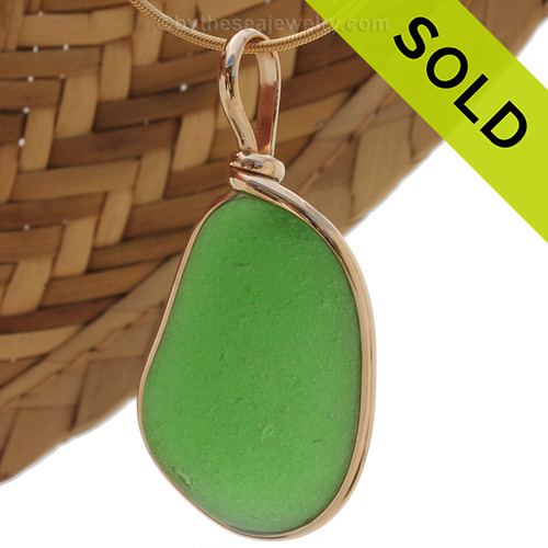 Great vivid green piece of natural sea glass in my Original Gold Wire Bezel© a simple design that lets all the beauty of this glass shine. Classic and timeless design that does not alter the sea glass from the way it was found on the beach. Sorry this Sea Glass Jewelry selection has been SOLD!