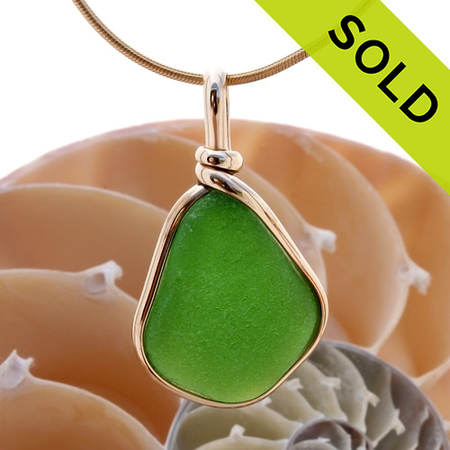 A vivid bright green piece of natural sea glass in my Original Gold Wire Bezel© a simple design that lets all the beauty of this glass shine. SOLD - Sorry this Sea Glass Pendant is NO LONGER AVAILABLE!