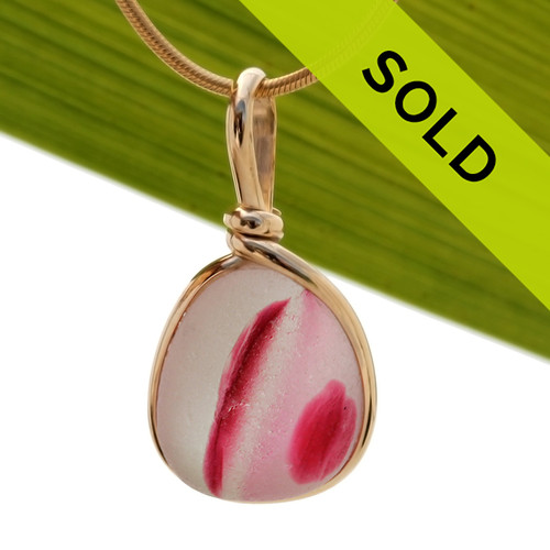 A smaller piece of stunning mixed hot pink and pure white English sea glass from Seaham England set in our Original Wire Bezel© necklace pendant setting in 14K Goldfilled.