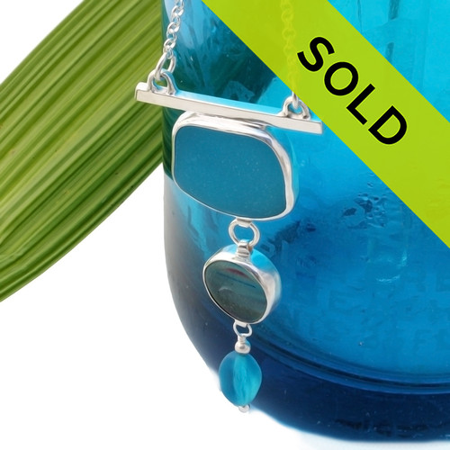 Ultra rare opaque turquoise blue sea glass and a piece of rare Seaham Sea glass set in a fine setting. Sorry this one of a kind sea glass jewelry piece has been sold!