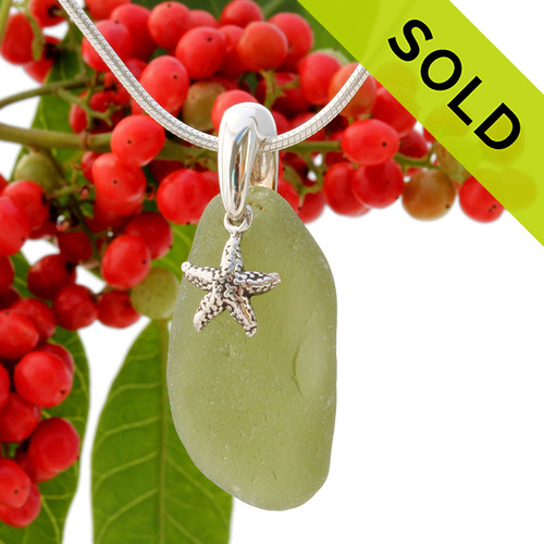 Beach found olive green sea glass is combined with a solid sterling starfish charm and presented on an 18 Inch solid sterling snake chain. Sorry this Sea Glass Jewelry piece has been SOLD!