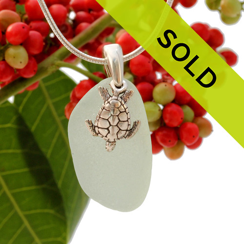 Beach found seafoam green sea glass is combined with a solid sterling sea turtle charm and presented on an 18 Inch solid sterling snake chain. Sorry this sea glass necklace has been sold!