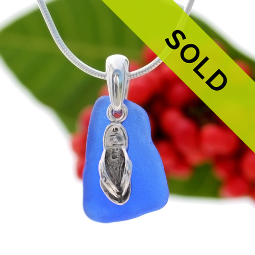 Beach found cobalt blue sea glass is combined with a solid sterling bail and finished with a S/S detailed Flip Flop Charm on an 18 Inch solid sterling snake chain. Sorry this sea glass necklace has sold!
