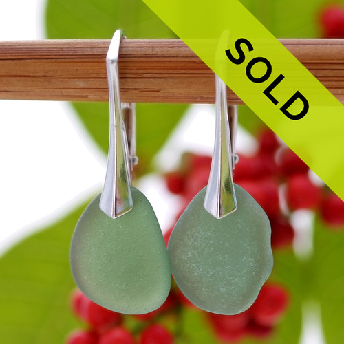 A pair of natural surf tumble sea glass earrings in an unusual green on sterling leverbacks. Sorry this pair has sold!