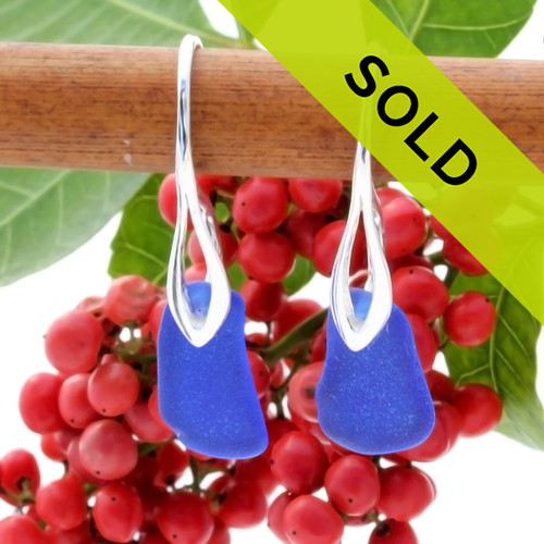 A pair of natural surf tumble sea glass earrings in a lucky cobalt blue on sterling deco hooks.