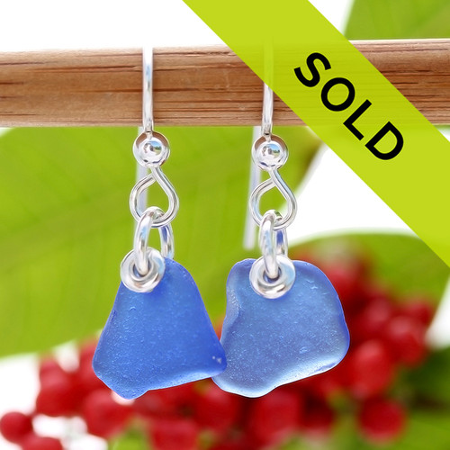 A pair of natural surf tumble sea glass earrings in a lucky cobalt blue on sterling fish hooks. Sorry this sea glass jewelry item has been sold!