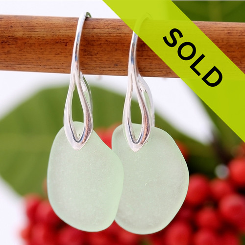 A pair of beach found Sea Glass Earrings in an Seafoam Green on Sterling Silver Deco Hooks. Sorry these sea glass earrings have been sold!