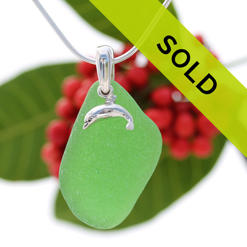 Beach found green sea glass is combined with a solid sterling dolphin and presented on an 18 Inch solid sterling snake chain.