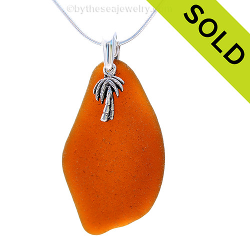 Beach found bright amber sea glass is combined with a solid sterling Palm tree and presented on an 18 Inch solid sterling snake chain. Sorry this Sea Glass Necklace has been SOLD!