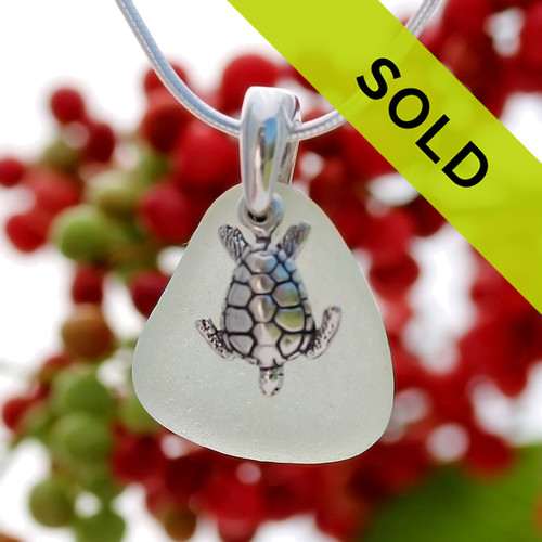 Seafoam Green natural beach found Sea Glass is combined on a Solid Sterling cast bail with a detailed sea turtle and presented on an 18 Inch solid sterling snake chain Sorry this sea glass necklace has been sold!
