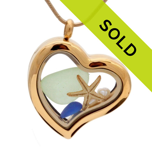 A stunning goldtone stainless steel locket necklace with blue and seafoam green sea glass, pearls and a real starfish. Sorry this sea glass jewelry item has been sold!