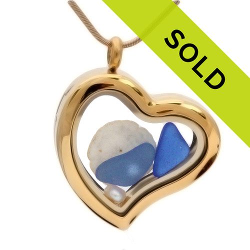 Sorry this sea glass jewelry piece has been sold!  Blue Sea Glass Locket Necklace W/ Real Sandollar & Freshwater Pearls