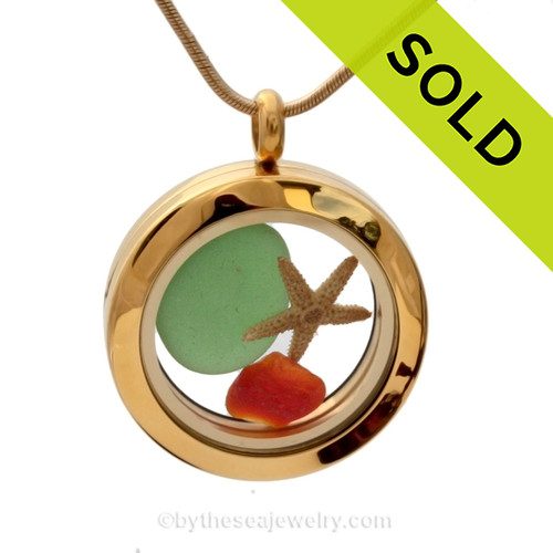 A festive goldtone stainless steel locket necklace with green and VERY RARE Red sea glass and a real starfish. Sorry this Sea Glass Jewelry piece has been SOLD!