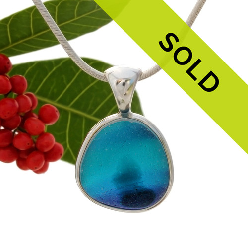 This sea glass is fused vivid teal, purple and aqua bright blue inside a base of  pure white.  It is set in our  sterling silver Deluxe Wire Bezel© setting. Very Versatile and elegant. CLASSIC! Sorry this one of a kind sea glass necklace pendant has been sold!