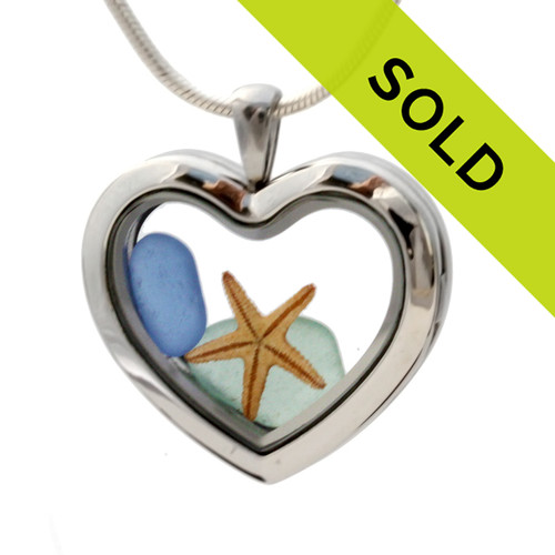 Small tropical Aqua  and Carolina Blue sea glass pieces combined with a real starfish in a feminine heart shaped locket magnetic stainless steel locket necklace! Sorry this sea glass jewelry piece has been sold!