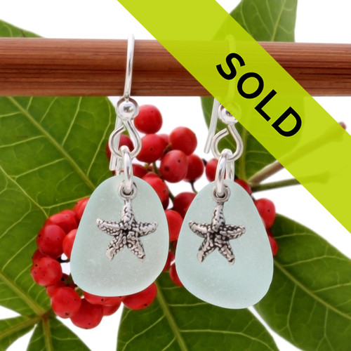 Airy and light pale aqua green sea glass earrings in sterling with sterling starfish charms Sorry this sea glass jewelry item has been sold and is no longer available.