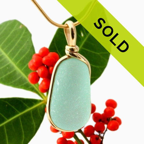 Sorry this sea glass jewelry item has been sold! A perfect piece of aqua green with in our signature Original Wire Bezel© pendant setting that leaves both front and back open and the glass unaltered from the way it was found on the beach.