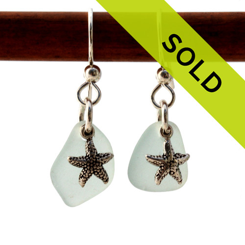 Natural Pale Aqua sea glass pieces are set with solid sterling  starfish charms and are presented on sterling silver fishook earrings. Sorry this sea glass jewelry earring selection has been sold!