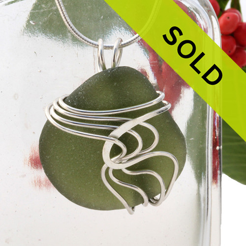 A nice piece of top quality thick olive green sea green natural beach found sea glass in a my signature Waves© sterling necklace pendant setting. Sorry this sea glass jewelry piece has been sold!