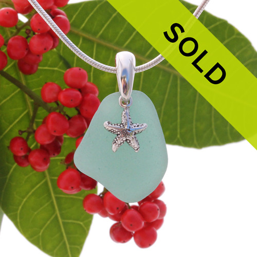 """Bright Teal sea glass set on a solid sterling cast bail with a sterling silver Starfish charm. The sea glass necklace comes on our 18"""" solid sterling smooth snake chain (SHOWN and included) Sorry this sea glass jewelry piece is no longer available!"""