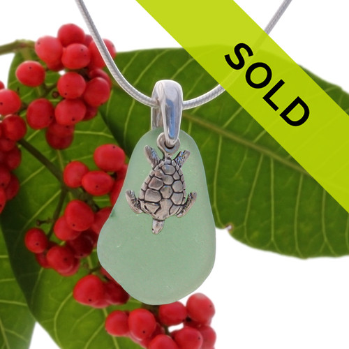 Beach found teal green sea glass is combined with a solid sterling sea turtle charm and presented on an 18 Inch solid sterling snake chain. Sorry this sea glass jewelry piece has been sold!