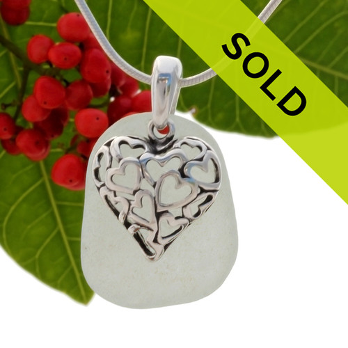 Beach found pale seafoam green sea glass is combined with a solid sterling Hearts In Heart cutour charm and presented on an 18 Inch solid sterling snake chain. Sorry this sea glass jewelry item has been sold!
