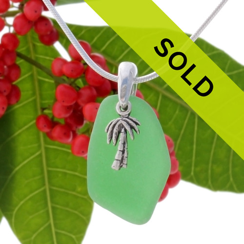 Beach found vivid green sea glass is combined on a hand cast bail presented and finished with a sterling palm tree on an 18 Inch solid sterling snake chain.  Sorry this sea glass necklace has been sold!