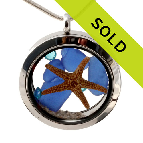 Vivid aqua gemstones, real Blue Sea Glass and a real larger starfish and beach sand are snug inside this one of a kind sea glass locket necklace. Sorry this sea glass jewelry piece has been sold!