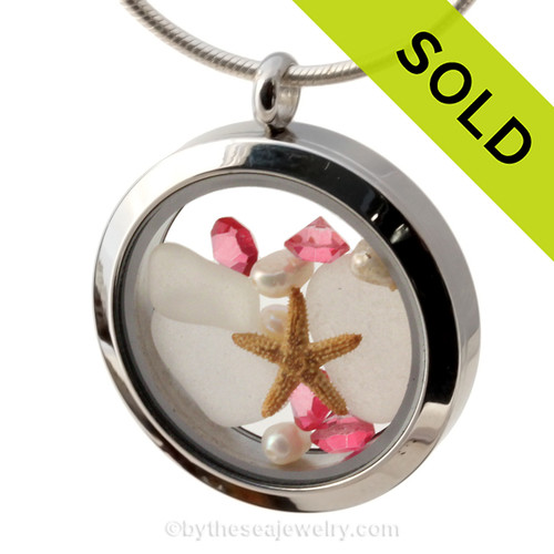 Pure White sea glass combined with a real starfish and brightened up a pink tourmaline gems and fresh water pearls. Tourmaline comes in many shades but pink is the most desirable.  Sorry this piece of Sea Glass Jewelry is no longer available.