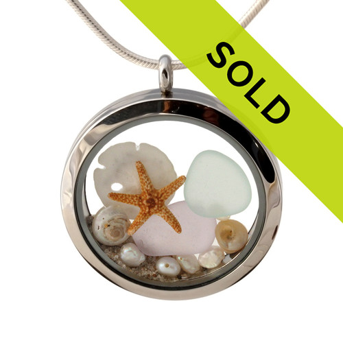 Pure white, rare depression pink and yellow sea glass combined with a real sandollar, pearls and real beach sand in this 30MM stainless steel locket.