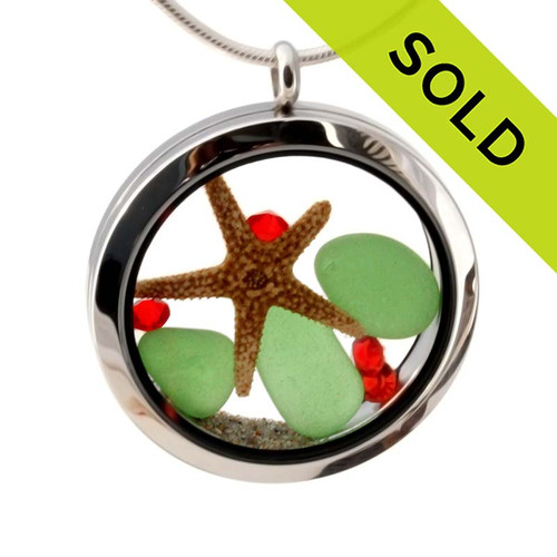 Genuine green sea glass pieces combined with a real starfish, vivid red gems and real beach sand in this 35MM stainless steel waterproof locket.